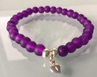 Purple matt bracelet with leaf charm