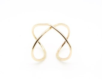 X REBEL RING (available in gold or silver)