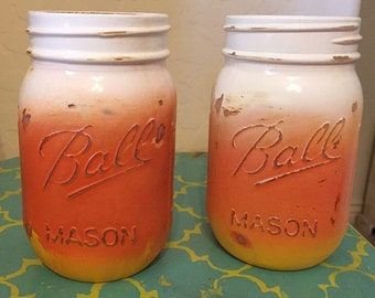 Candy corn inspired painted mason jars