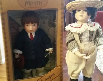 Pair of Porcelain Dolls.