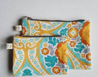 Floral zippered pouch with brass zipper