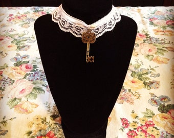 Pink lace choker with antique key.