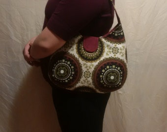 One-of-a-Kind Green and Burgandy Handbag with Magnetic Snap Closure.