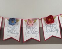 Happy Birthday Banner with Blue, Red, and Pink Flowers