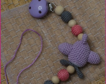 Pacifier Holder with crochet airplane.