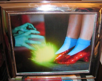 oz 'give me those slippers' silver framed art.