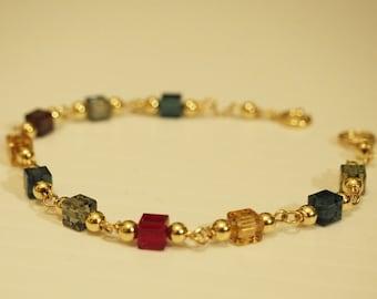 14k gold filled bracelet. Multicolor swarovsky crystals. Cube Swarovski crystals Siam, Black diamond, smoked topaz and montana