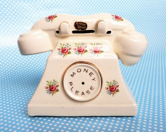 Vintage telephone money box made by Arthur Wood in the 1950s