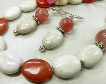 White gem set with red jade