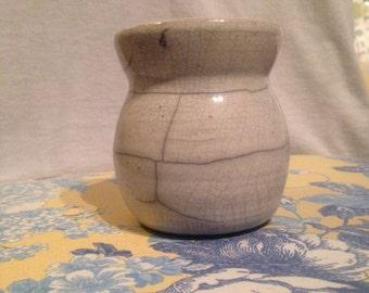 white racu-fire vase