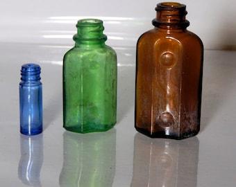 Three vintage screw top bottles