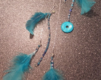 Teal beaded feather hairpiece