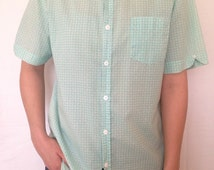 100% cotton turquoise and white short sleeved button down shirt size M