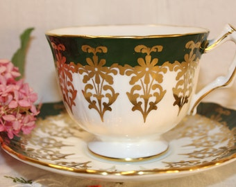 Aynsley: Crocus tea cup and saucer, white, green and gold