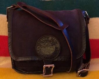 Vintage Duluth Pack mini haversack black canvas and leather messenger cross body bag made in minnesota usa handbag