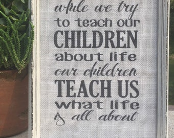 While we try to teach our Children,Quote on burlap,framed saying,inspirational quote,Family saying,Gallery wall decor,Family room decor