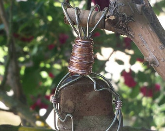 Polished stone wire wrapped pendant