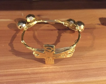 Gold hammered cross bangle