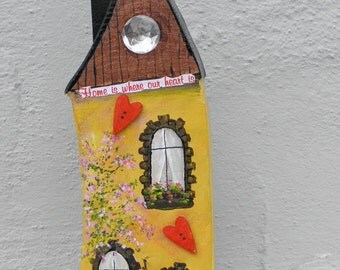 "Decorative wooden house ""home is where our heart is"