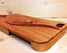 iPhone case made of brass frame and wood with carved frog