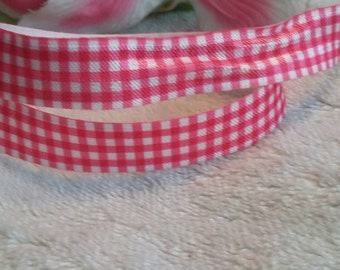 "3 yards, 5/8"" pink and white fold over elastic."