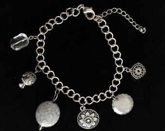 Charm bracelet featuring custom beads and flower charms