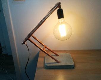 Copper lamp and concrete, light bulb filament