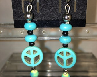 Faux Turquoise earrings with peace symbol and skulls