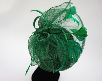 Green headdress with feathers