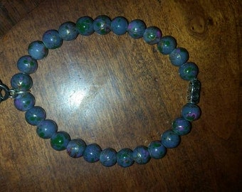 Bluish gray beaded bracelet with knot charm