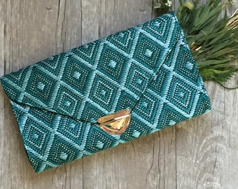 The Trixie Teal Clutch