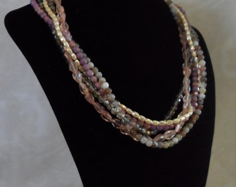 Five strand Czech and Pearl necklace in a plum color.