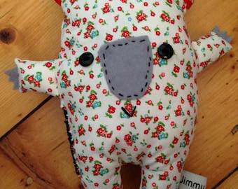White and red floral wombat softie