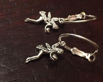 silver fairies carrying hearts earrings