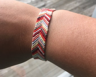 Red and Neutral Friendship Bracelet with Flower Toggle