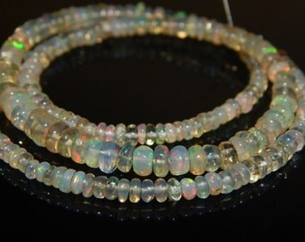"""15.5""""Inches Ethiopian Fair Opal Smooth Beads Rondelle Shape 3x5.5 mm Approx"""