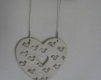 Heart shaped little bird wall hanging