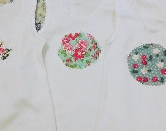 pretty floral handstitched appliqued baby vests.