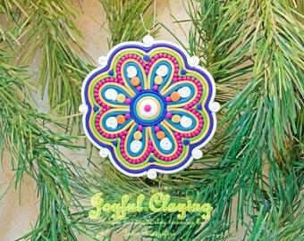 Mixed media blue/red/ecru Clay Ornament