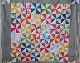 Beautiful colourful pinwheels; wall hanging/table decoration/quilt with button detail
