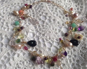 Necklace with precious stones in 14 carat gold