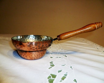 Hand wrought copper pot with wooden handle