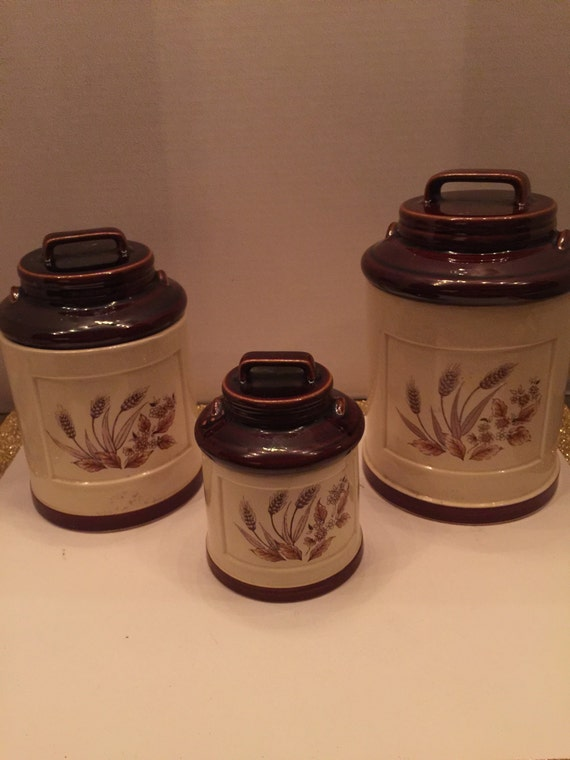 vintage canister set with brown trim and lids 3 piece set
