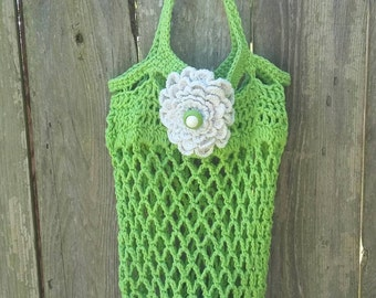 Lime green crocheted cotton turtle market bag with white flower and buttons