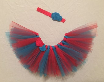 Red and Turquoise/blue Tutu. Great for pictures and/or birthday party Dr. Suess party theme. Embellished with fabric rosettes. Headband incl