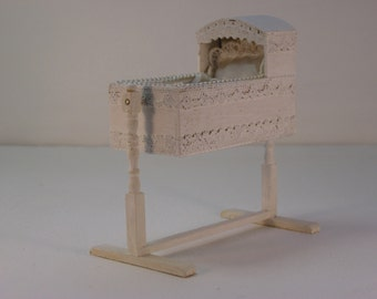 White lace rocking cradle