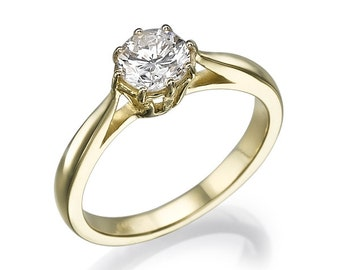 ring hand made gold 14 karates with special Crown 0.73 CT