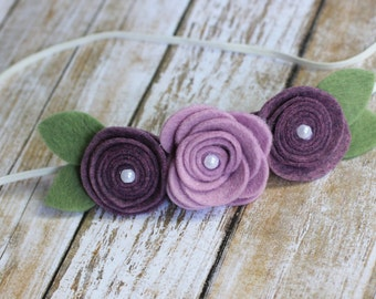 Adorable plum and lavender flower headband.