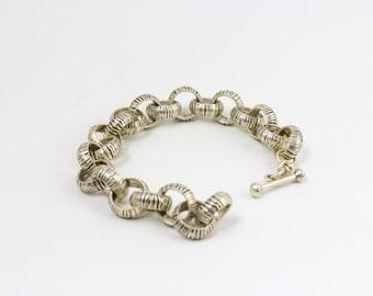 Silver interwoven link bracelet