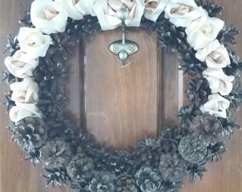 Pinecone and satin ribbon rose wreath